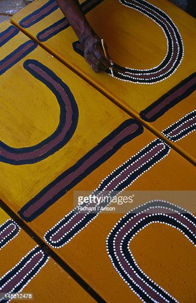 Aboriginal artist painting.