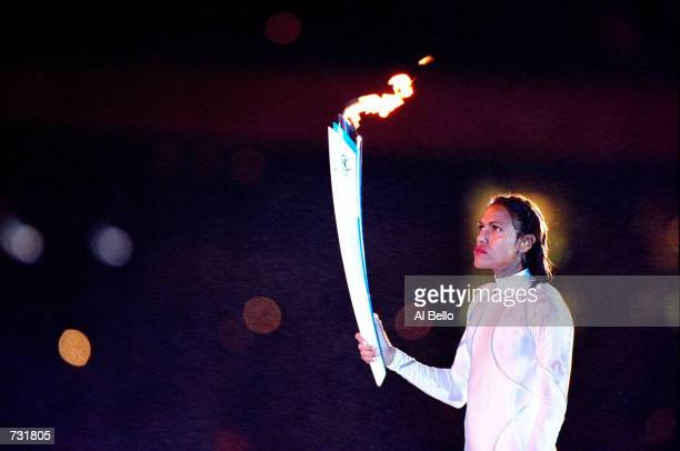 Aboriginal Australian Cathy Freeman holds the Olympic torch prior to lighting the Olympic flame September 15 2000 during the opening ceremonies of...