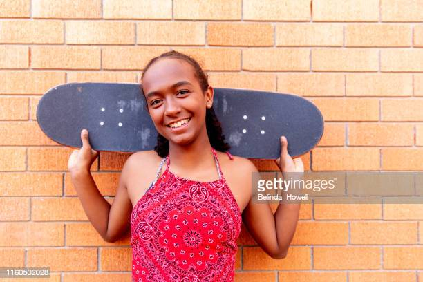 aboriginal australian teenager walking through her city streets, with her mother, posing. - thisisaustralia stock pictures, royalty-free photos & images