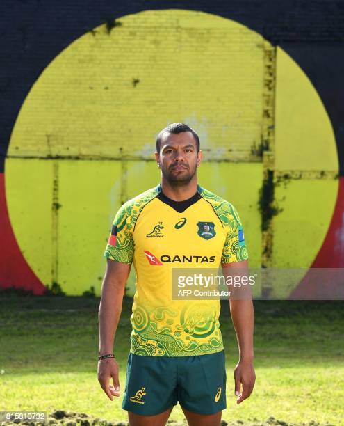 Aboriginal Australian Wallabies rugby player Kurtley Beale models an indigenousthemed jersey in front of a giant Aborigine flag painted on the side...