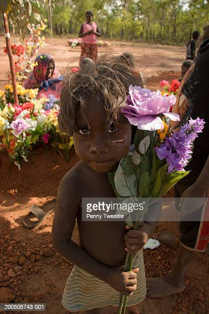 Aboriginal child with flowers for funeral, portrait