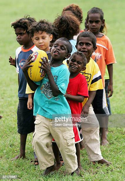 Aboriginal children participate in a coaching clinic with players from the Western Bulldogs during the Western Buldogs Football Club community camp...
