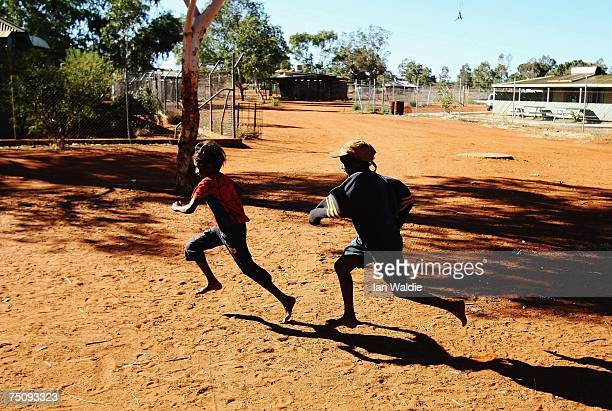 Aboriginal children play as Indigenous Affairs Minister Mal Brough meets with the Mutitjulu community elders July 6 2007 in Mutitjulu near Alice...