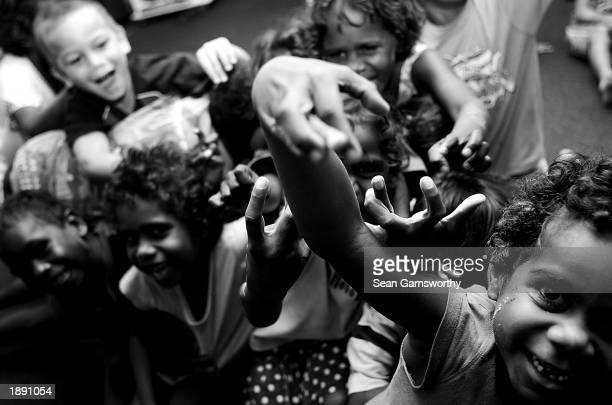 Aboriginal children pose for the camera during an Australian Football League tour of Darwin and the Tiwi Islands in Australia on April 2 2003
