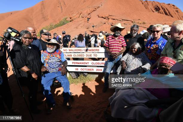 Aboriginal elders gather for a ceremony ahead of a permanent ban on climbing Uluru that comes into place on October 26, at Uluru, also known as Ayers...