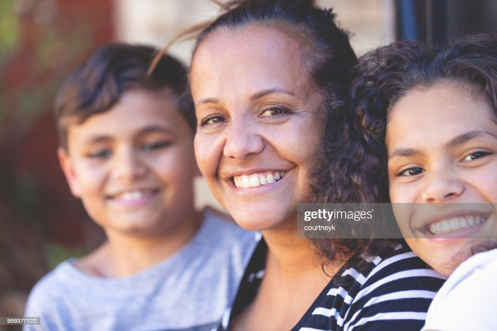 Aboriginal Family portrait with 1 parent and 2 children. : Stock Photo