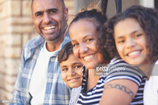 Aboriginal Family portrait with 2 parents and 2 children.
