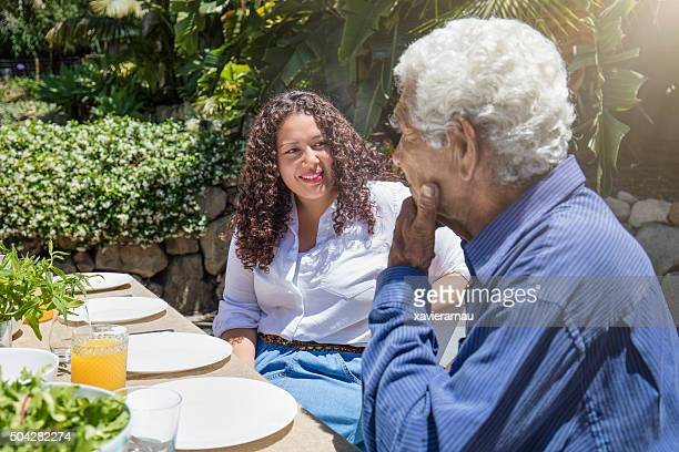 Aboriginal father talking with his daughter on a barbecue