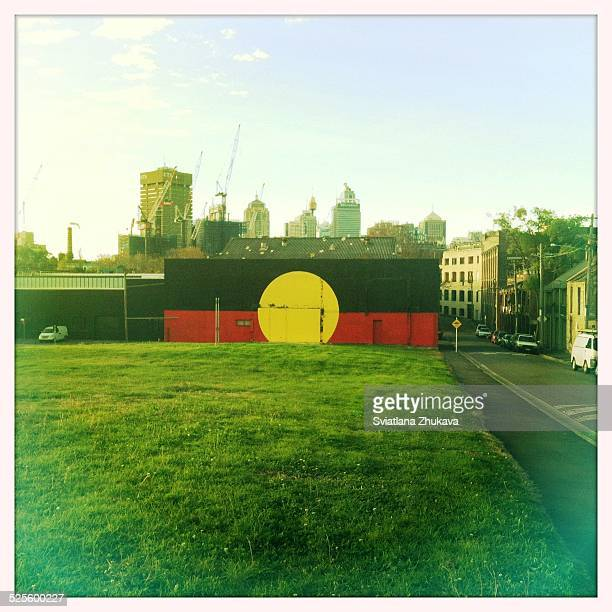 Aboriginal flag painted in a wall in Redfern