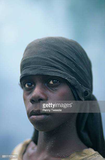 Aboriginal girl Alena from Kurrurldul whose dreaming is Dangarrak 'fire in water' Central Arnhem Land returning from a 'burnoff' she is spotted with...