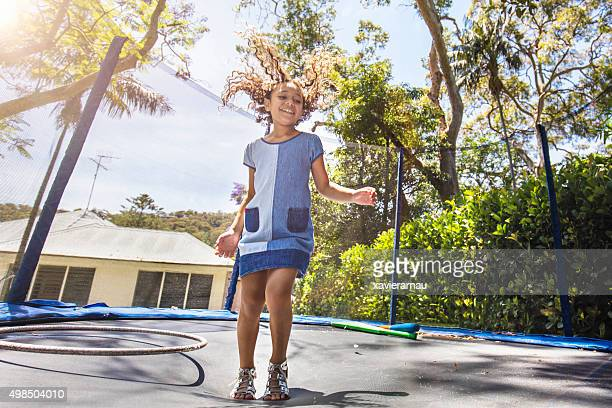 Aboriginal girl bouncing on the trampoline