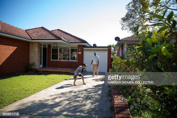 Aboriginal indigenous Australian father and son playing with basketball