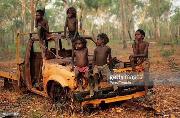 Aboriginal kids play on one of the many abandomed trucks found in the bush central Arnhem Land Oscar's grandchildren Isiah Messiah Rebecca Isaaciah...