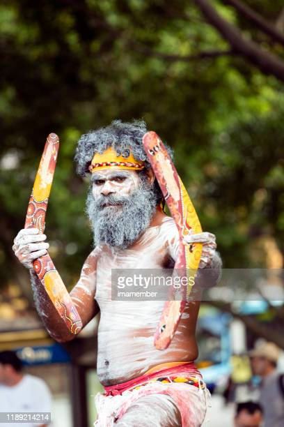 aboriginal male dancing with boomerangs, sydney australia, copy space - boomerang stock pictures, royalty-free photos & images