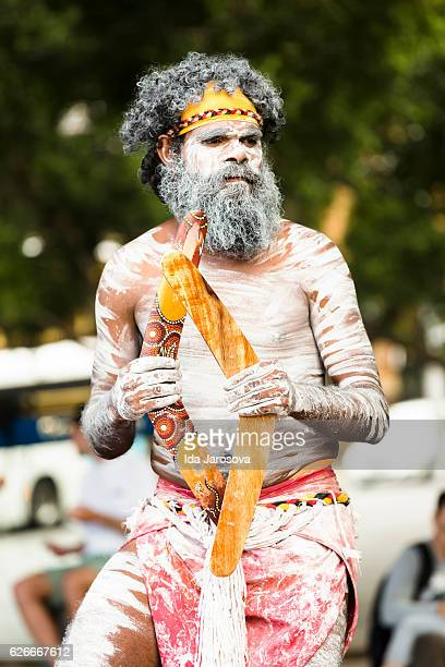 aboriginal male dancing with boomerangs, sydney australia - ceremony stock pictures, royalty-free photos & images