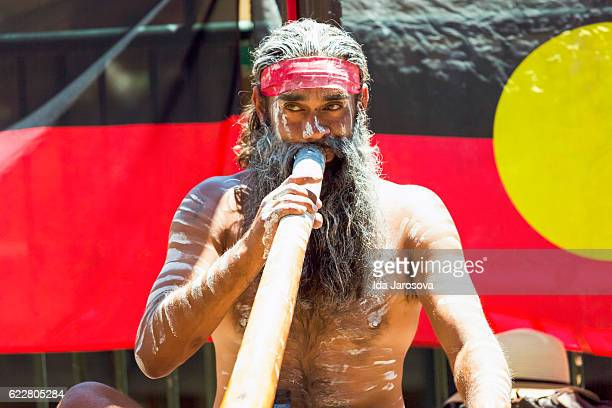 Aboriginal male playing didgeridoo, street performer, Sydney Australia