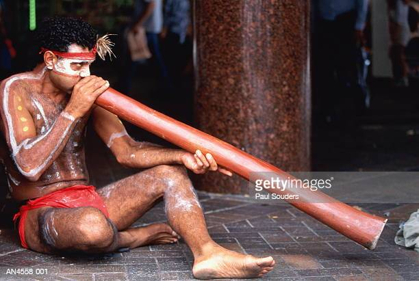 Aboriginal man playing dijeradoo,Sydney,Australia