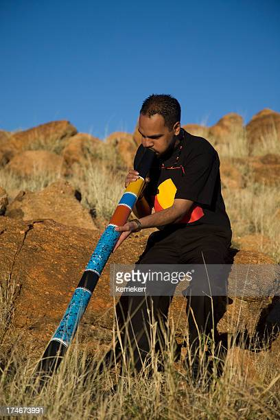 Aboriginal Man playing the Didgeridoo