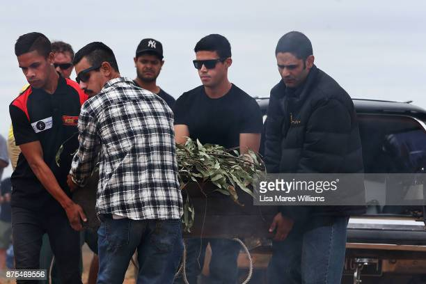 Aboriginal men carry the 40000 year old remains of Mungo Man and ancestors from a hearse on their arrival to the Lake Mungo ceremony overlooking the...
