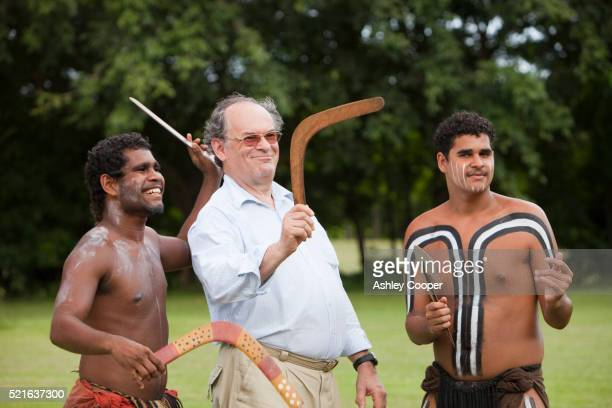 Aboriginal men with tourist holding boomerang