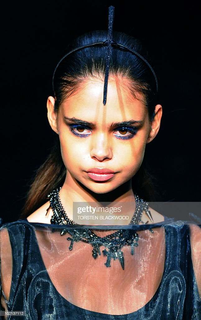 Aboriginal model Samantha Harris parades a summer dress by Fernando Frisoni during Australian Fashion Week in Sydney on May 6, 2010. The event highlights Australia's leading apparel designers as well as the up and coming. AFP PHOTO / Torsten BLACKWOOD