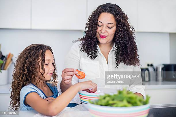 Aboriginal mother and daughter preparing fresh salad