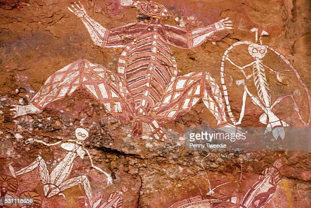 Aboriginal paintings depicting xray figures stand on Nourlangie rock in Arnhem Land Northern Territory Australia | Located in Kakadu National Park
