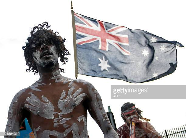 Aboriginal performers guide the Indigenous and Torres Straight Islander war veteran march on ANZAC Day in Sydney's Redfern on April 25 2008 Hundreds...