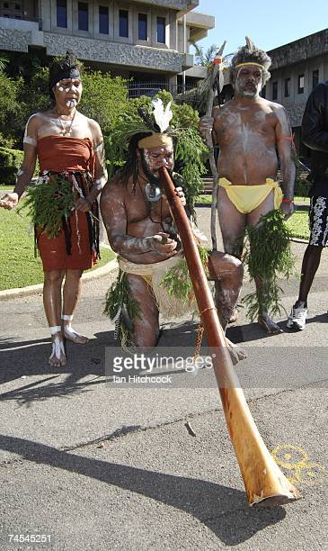 Aboriginal performers Stephanie Miller Jai Cummins and Farron Merrypor perform outside the Townsville Courthouse June 12 2007 in Townsville Australia...