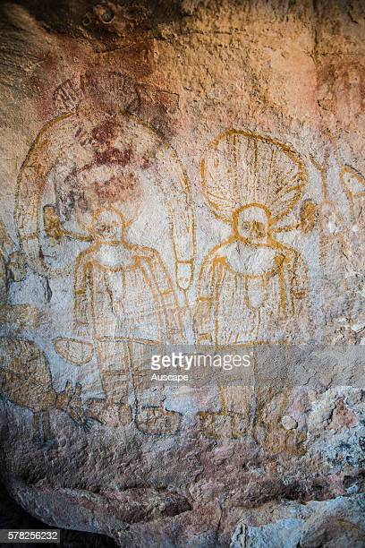 Aboriginal rock paintings of figures with enormous headdresses or hats on Bigge Island about 20 km from the mainland at Cape Pond Bonaparte...