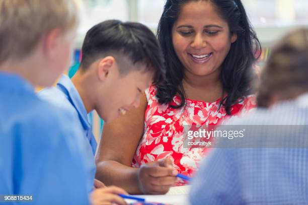 aboriginal school teacher with students. - teacher stock pictures, royalty-free photos & images