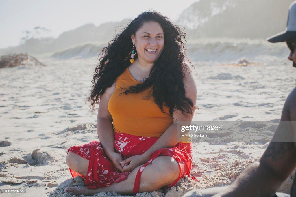 Aboriginal woman and her boyfriend at the beach
