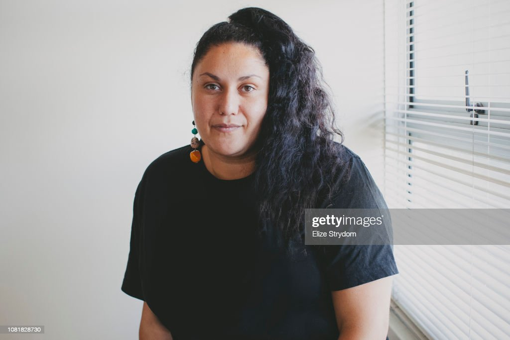 Aboriginal woman by an office window : Stock Photo