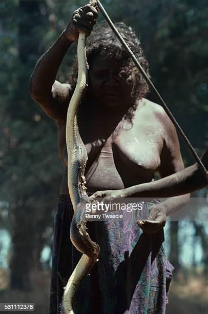 Aboriginal woman Elsie Ganbada with the freshwater python she has just caught central Arnhem Land
