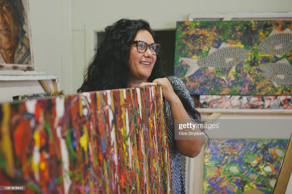 Aboriginal woman in art studio