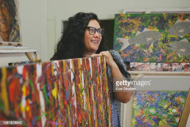 Aboriginal woman in art studio