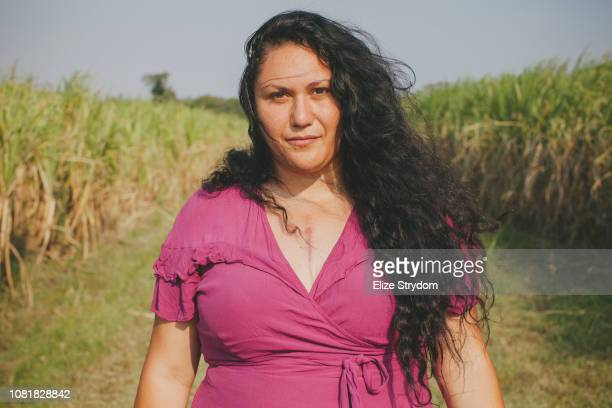 aboriginal woman in cane field with chest scar - scar stock photos and pictures