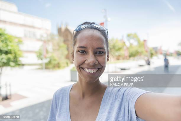 Aboriginal woman taking selfie - POV