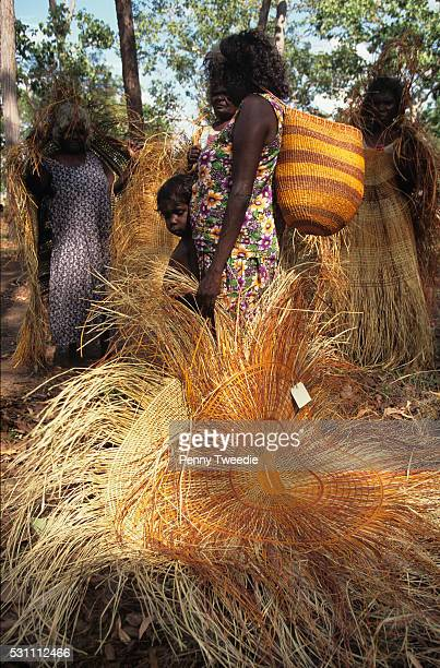 Aboriginal women weavers bring their pandanus mats and baskets to Ramingining central Arnhem Land From here they will be sold and earn the women some...