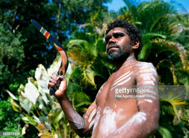 Aborigine Man Holding Boomerangs