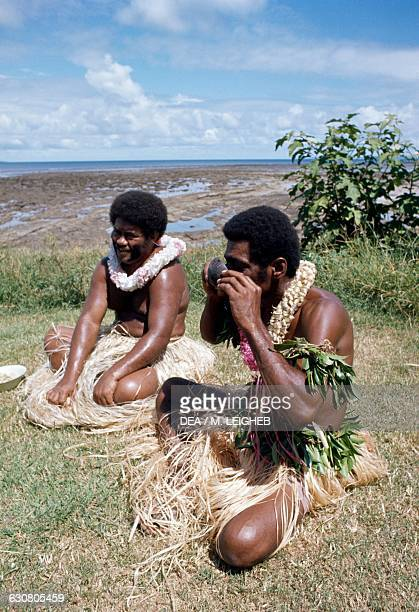 Aborigines drinking a traditional drink made from kava roots and coconut milk Fiji