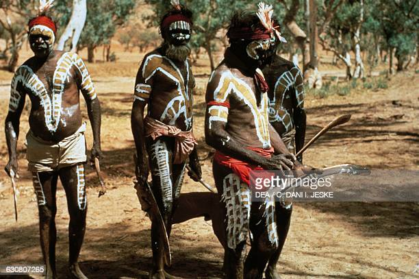 Aborigines from the Tiwi tribe painting for a ceremony Australia