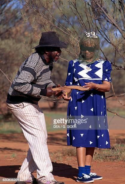 Aborigines holding a boomerang Alice Springs Northern Territory Australia