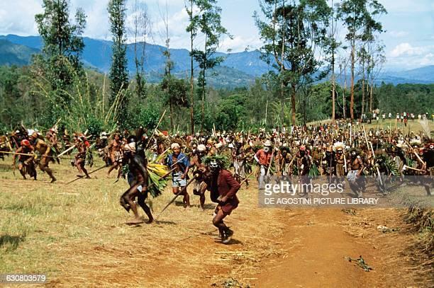 Aborigines performing a war dance Highlands Asaro Valley Papua New Guinea