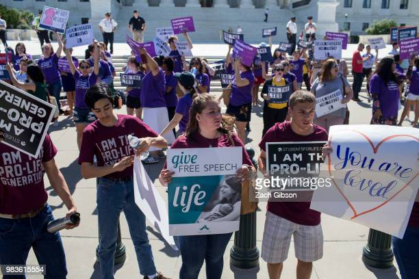 Abortion opponents and supporters hold signs in front of the US Supreme Court on June 25 2018 in Washington DC The high court is expected to issue...