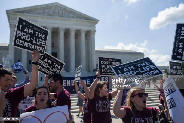 Abortion opponents hold signs in front of the US Supreme Court on June 25 2018 in Washington DC The high court is expected to issue decisions in six...