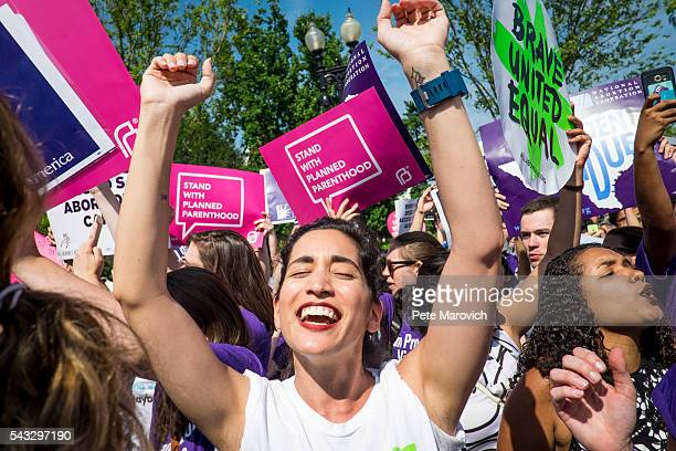 Abortion rights activist Morgan Hopkins of Boston celebrates on the steps of the United States Supreme Court on June 27 2016 in Washington DC In a 53...