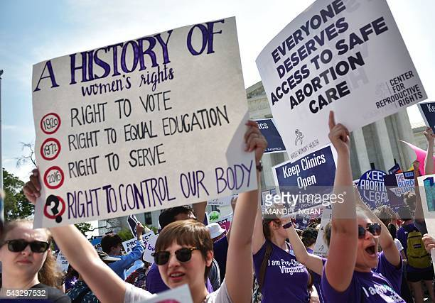 Abortion rights activists cheer after the US Supreme Court struck down a Texas law placing restrictions on abortion clinics outside of the Supreme...