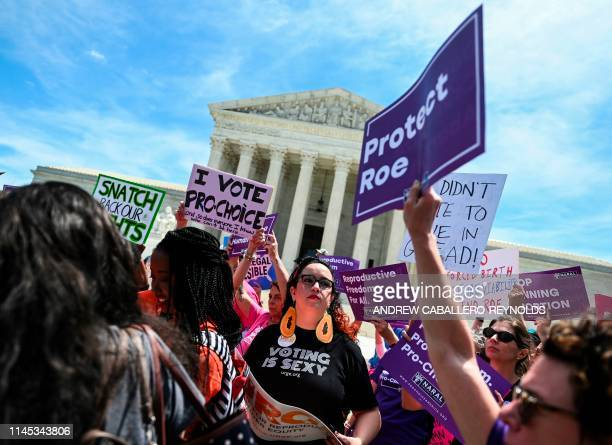Abortion rights activists rally in front of the US Supreme Court in Washington DC on May 21 2019 Demonstrations were planned across the US on Tuesday...