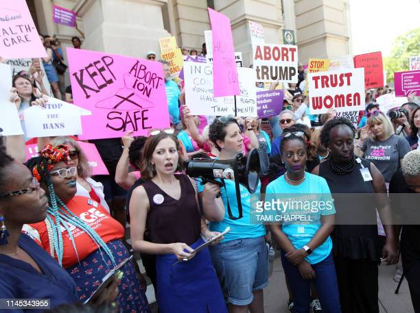 Abortion rights advocates including NARAL Georgia Director Laura Simmons rally in front of the Georgia State Capitol in Atlanta to protest new...